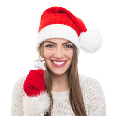Cute Santa girl showing silver star Christmas decoration