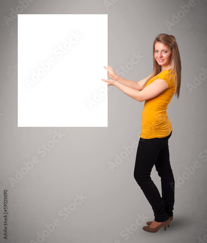 Young woman presenting white paper copy space