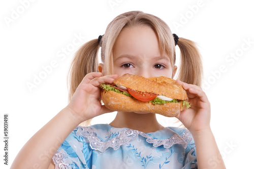 canvas print picture Kind beim Essen eines belegten Brötchen