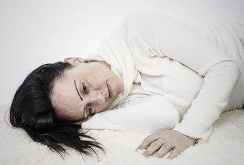 depressed woman lying on floor with copy space