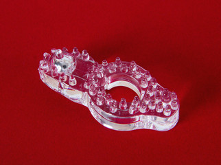 Transparent ring for penis erection on red