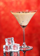 Baileys liqueur in glass on red background