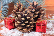 Christmas decoration with pine cones on wooden background