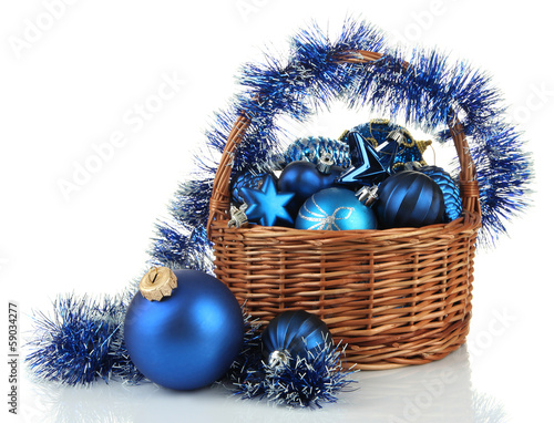 Christmas decorations in basket isolated on white