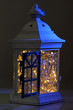 Decorative glowing lantern at night