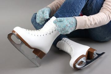 Skater wearing skates on gray background