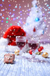 Wine glasses and Christmas decoration on bright background