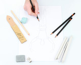 Hand draws a sketch with professional art materials, isolated