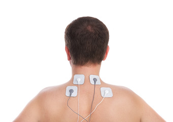 Man neck and in spine massage makes electrostimulator.