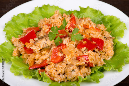 Rice with vegetables and chicken in a curry sauce