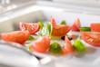 Closeup of a fresh tomato and basil salad.