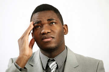 Headache or stress, businessman holds head