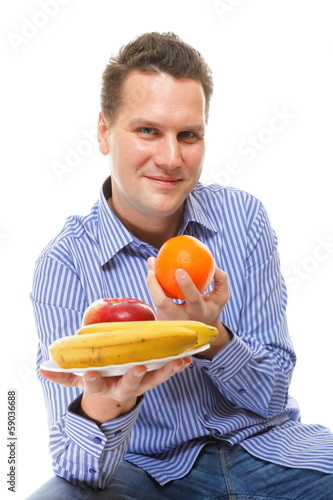 young man with fruits healthy diet isolated
