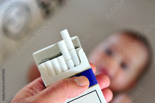 Smoking near children concept photo