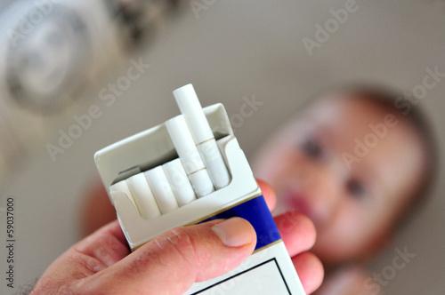 Leinwandbild Motiv Smoking near children concept photo