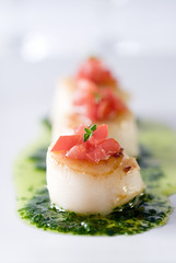 scallops with parsley pesto, tomatoes and thyme.