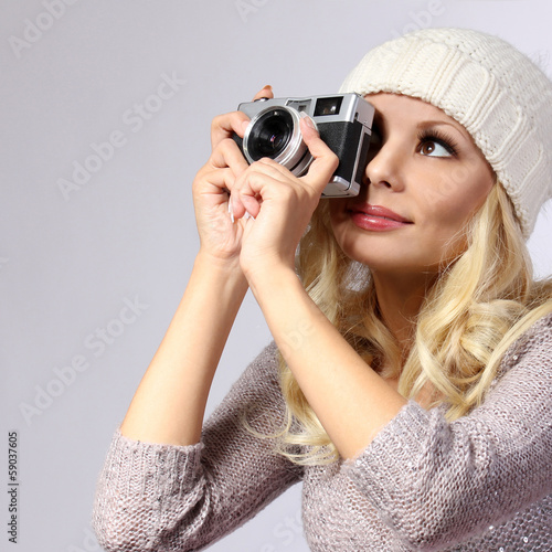 Photographer. Beautiful woman taking photo with film camera