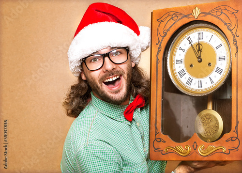 Photo of stunned Santa holding clock showing five minutes to mid