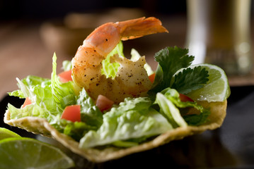 tostada with vegetables and shrimp.