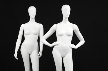 Two mannequin woman isolated on black