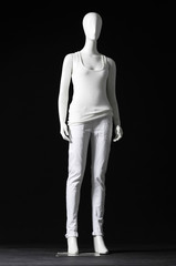 full-length mannequin dressed in white t-shirt and trousers