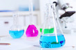Chemistry laboratory glassware with colour liquids