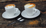 two cups of coffee cappuccino