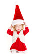 little girl in a cap of Santa Claus isolated on white background