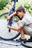 Teenager repairing his bike, changing broken tyre