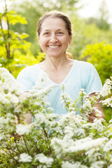 Happy mature woman at garden