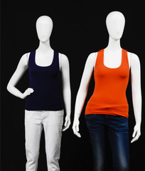 Two mannequin dressed in red and black l shirt and trousers