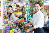 gardener buys solid fertilizer  at market
