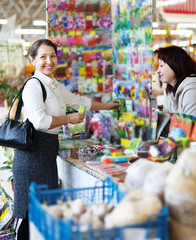 mature woman in store for gardeners