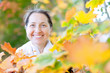Portrait of happy  woman  in autumn