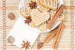 Gingerbread cookies with spices on bamboo background