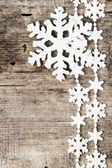 Christmas decoration. Snowflake ornament on wooden background