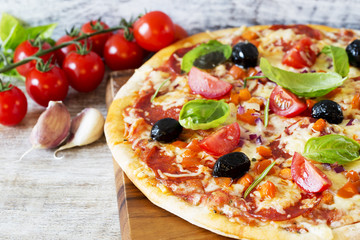 Pizza - Italian pizza with salami and black olives