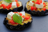 Grilled eggplant with feta cheese, red peppers