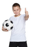 Fototapety Young boy with soccer ball
