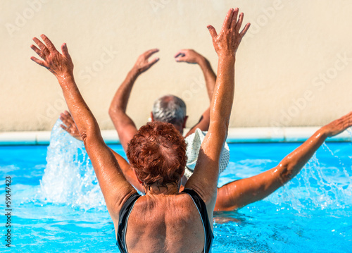 Active seniors getting a workout at the swimming pool