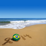 Soccer ball with Brazilian flag and 2014 on beach