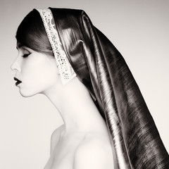 Retro portrait of young woman in a headscarf.