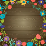 Wood texture background with various flowers.
