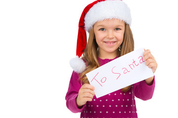 Little smiling girl holding letter for Santa Claus.