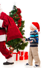 Surprised upset little boy watching Santa Clause leaving.