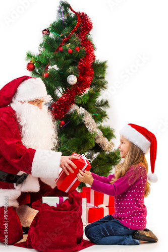 Santa Claus in red costume giving present from the bag.