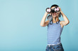 Leinwanddruck Bild - little sailor with binoculars on sky blue background