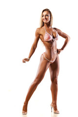 pretty muscular woman posing on white background