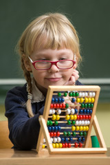 girl in school working with abacus