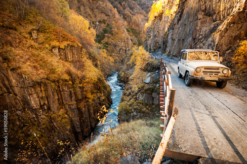 SUV into the Caucasus mountains on a mountain road